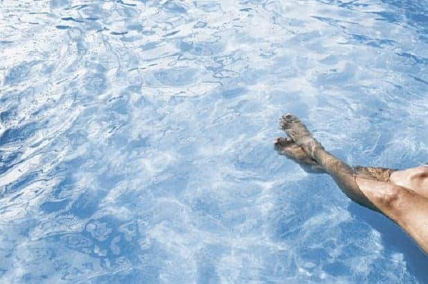 Low section view of a person in a swimming pool